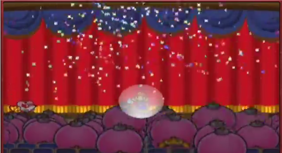 Figure 13: Mario levels up on the battle stage, in a spotlight showered in confetti as the audience of pink Bob-Ombs jumps in approval.