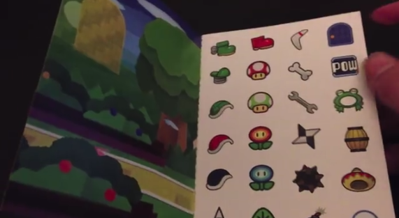 Figure 27: The Sticker Star sticker book, given out by Club Nintendo. Still from a YouTube video by James Berryman.